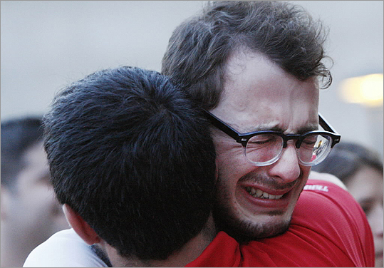 Boston University student Blake Wrobbel, of Los Angeles, got emotional during the candlelight vigil on Marsh Plaza at Boston University on May 12.