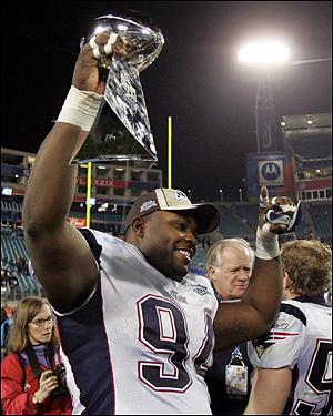 Ty Warren, celebrating a Super Bowl victory