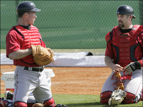 Flaherty (left), who played with the Yankees last year, has to be condidered the frontrunner to back up catcher Jason Varitek (right).
