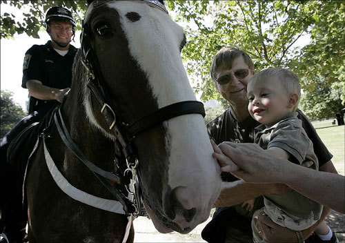 Boston Police Mounted Officer Gerry Boyce and his horse Shorty met with almost-2-year-old Jason Davis and his grandfather, William.