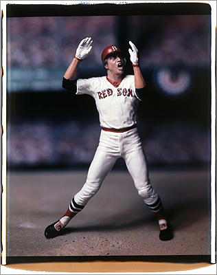 Carlton Fisk? The famous catcher was born in Bellows Falls, Vt., and grew up in New Hampshire. But we can't seem to find any documents supporting the internet claims that Fisk lived in Belmont. He did play for the Red Sox and is known for jumping and waving at a ball he had just hit toward foul territory as if willing it into fair territory during the 1975 World Series.