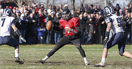 Marblehead gave its fans a lot to cheer about when the Magicians faced off against Swampscott at Marblehead High School for the annual Thanksgiving Day game. Marblehead won, 21-7. Marblehead quarterback Ian Maag (No. 7, center) looks for a receiver.