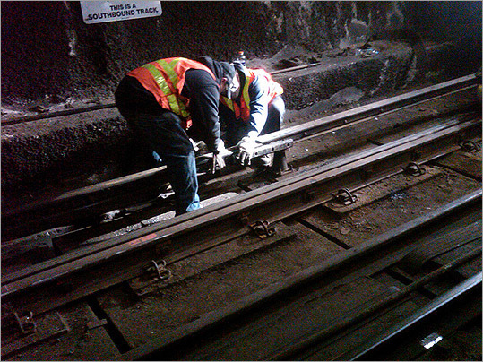 Workers installed a new third rail.