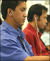 At eData, Filipino medical transcribers listened to information from US doctors through earphones.