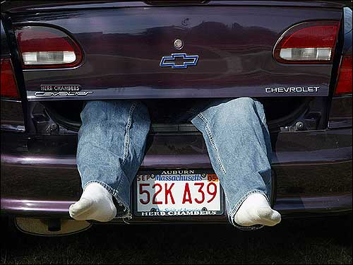 It wasn't just the runners who suffered in the heat. Pat Sullivan, of Charleton, gets some rest away from the hot sun inside the trunk of a friend's car while reserving a viewing spot on Hayden Rowe Street near the Marathon's starting line.