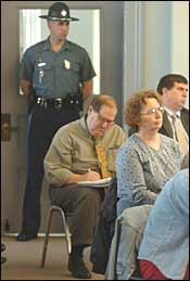 A State Police officer stood atthe door as municipal clerks gathered for a closed training session yesterday in Barnstable Town Hall on the issuing of marriage licenses for same-sex couples.