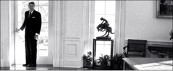 President Reagan pauses before leaving the Oval Office for the last time on Jan. 20, 1989.