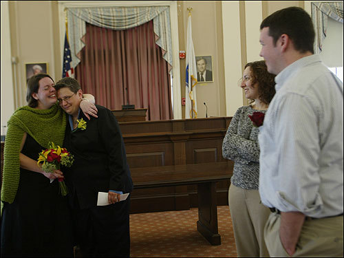 Newlyweds Amy (left) and Annette Whitehead-Pleaux of Somerville celebrate after the Somerville city clerk married them. Amy's friend, Jennifer Martinelli, of Charlestown, and Amy's brother, Christopher Whitehead, of Texas, look on after the short ceremony.