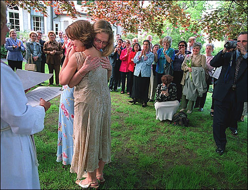 Later that afternoon, Deegan and Cervone embrace at a friend's home in Jamaica Plain after being legally married. The two realtors have been together for 12 years.