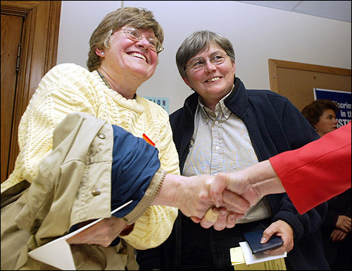 Just after midnight, Marcia Hams (left) and Susan Sheperd become the first couple to apply for a marriage license at Cambridge City Hall.