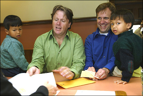 Kevin (left) and Arthur Patton-Hock of Somerville file their marriage license at City Hall. With them are their adopted sons, Mao (left) and Chet.