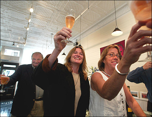 After a marriage ceremony on the beach, Counihan and Golden celebrate with champagne, friends, and family inside their gift shop on Commercial Street in Provincetown.