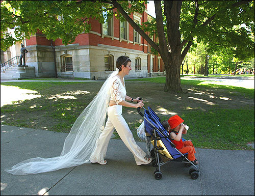 After the ceremony, Noonie Hammarlund heads to the playground with son Elijah, 3.