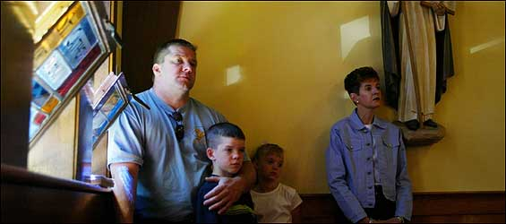 There was standing room only for the Timmons family yesterday morning at St. Albert the Great Church in Weymouth, which will close. Gerard Timmons (left), Matthew,Michaela, and Eileen attended morning Mass.