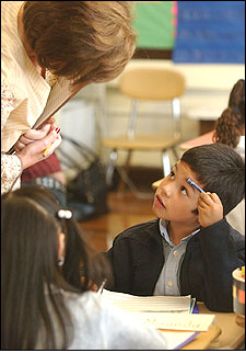 Alonso Martinez, a first-grader at the Otis School, listened to teacher Lavinia Maguzzu.
