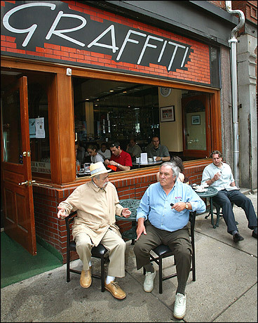 Like many restaurants in the North End, Caffe Graffiti on Hanover Street is open to the street on a fine day. Luigi DeMarco, whose family has owned the cafe for 14 years, says it takes good people and good ambiance to be successful. 'I know 80 percent of the people who walk through this door,' he says.