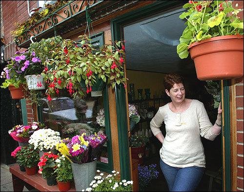 Patti McPartland owns The Antique Vase flower shop on Parmenter Street.
