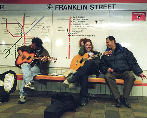 Downtown Crossing T Station Musicians Rico Holley (left) and Melissa Kaplan perform in the Downtown Crossing subway station.