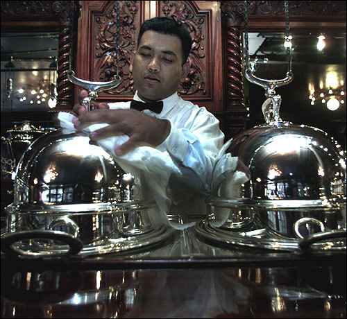 Lock-Ober Debashis Barua polishes antique soup tureens at Locke-Ober on Winter Place. Around since the early 1800's, the restaurant itself was built around 1875. The restaurant is currently owned by renowned chef Lydia Shire. Check out the original wooden floors, ornate ceilings, moldings, leaded glass, and mosaic tiles. 'This is the power lunch in Boston,' Mantouvalos says.