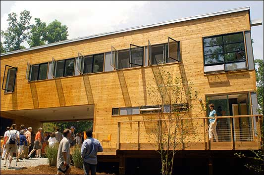 Visitors look at the Dwell Home