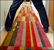 Decorators work on the home's flooring.