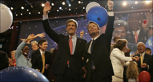 Democratic presidential nominee John Kerry and vice presidential nominee John Edwards wave to the FleetCenter crowd at the conclusion of the DNC.
