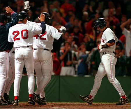Garciaparra is greeted at home plate after hitting the first grand slam of his career -- a walkoff shot to beat the Seattle Mariners in September 1998.