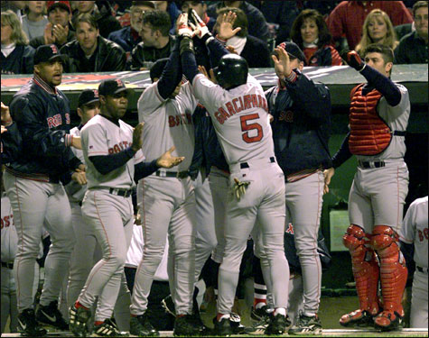 Garciaparra celebrates with his teammates after slamming a two-run home run in the first inning during Game 5 of the 1999 ALDS.
