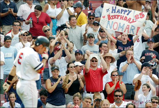 Fans cheer for Garciaparra as he approaches the plate looking to add to his three home runs on July 23, 2002, his 29th birthday. He became the first player in ML history to hit three home runs in back-to-back innings. He drove home eight in the contest, making him the first player in Red Sox history to have two career eight RBI games.