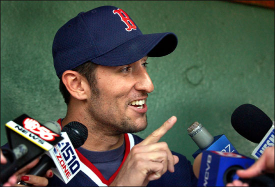 Garciaparra answers questions from reporters in September 2002 surrounding his free-agent status in the upcoming offseason. In the press conference, he reaffirmed his desire to stay in Boston.