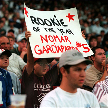 A young fan holds up a sign showing his support of Garciaparra for the Rookie of the Year award in 1997. Garciaparra hit .306 with 30 homers and 98 RBIs in his first full season.