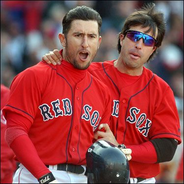 Garciaparra celebrates with Todd Walker after hitting a walkoff home run in the bottom of the ninth inning against Toronto on April 20, 2003. The Red Sox had trailed 5-0 in the contest, but rallied for a 6-5 win.