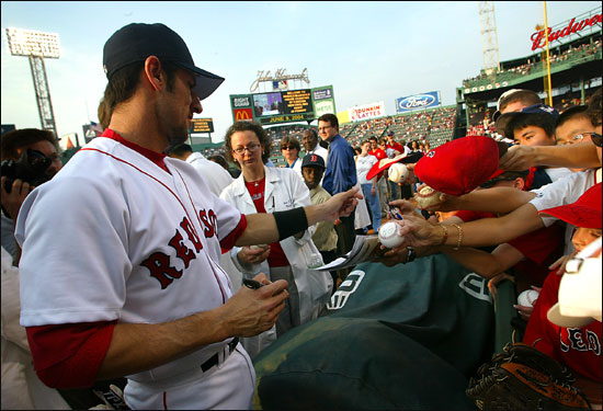 Garciaparra signs autographs before making his first start of the 2004 season on June 9. He had been sidelined since spring training with a nagging injury to his Achilles' tendon.
