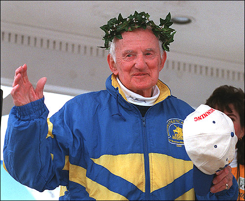Kelley waves to the crowd in Hopkinton before the 100th running of the Boston Marathon in 1996, following a ceremony in his honor.