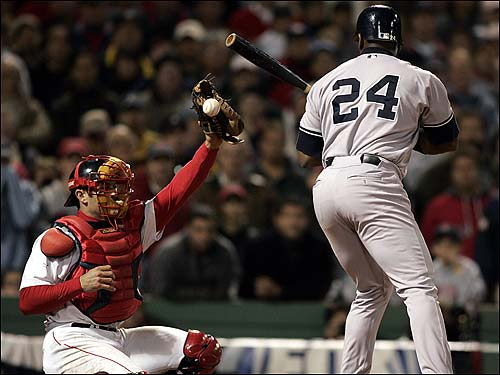 Jason Varitek had a hard time keeping Tim Wakefield's knuckle ball in his mitt, including this one with Ruben Sierra at the plate.