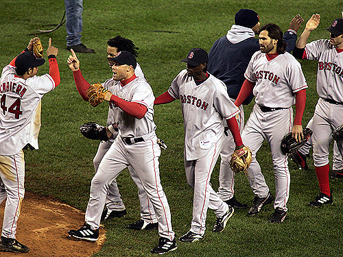 The Red Sox players celebrate their win.