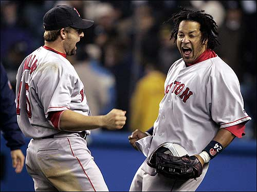 Kevin Millar and Manny Ramirez can't contain their excitement following the Red Sox victory.