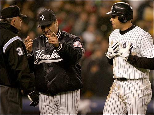 Joe Torre and Alex Rodriguez plead their case to the umpires, but it's to no avail.