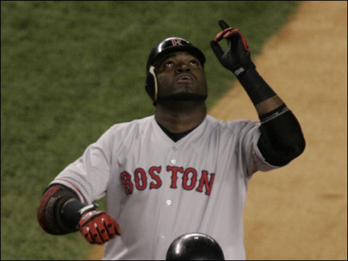 David Ortiz arrives at the plate after hitting a two-run homer to start off the game.