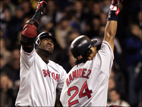 David Ortiz and Manny Ramirez celebrate after Ortiz's homer.