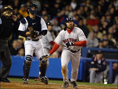 Home plate umpire Randy Marsh, New York Yankees catcher Jorge Posada, and Johnny Damon of the Boston Red Sox watch Damon's grand slam ball.
