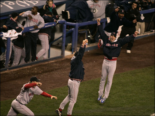 Derek Lowe leaps into the air after the Red Sox win the pennant.