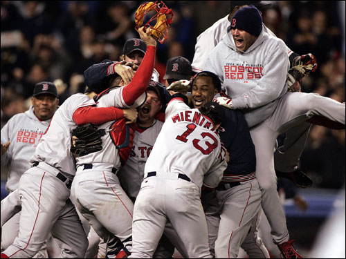 Joyous Red Sox players piled onto the field as the Yankee fans went home.