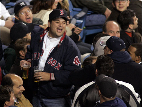 A Red Sox fan expresses his emotions during the eighth inning at Yankee Stadium.