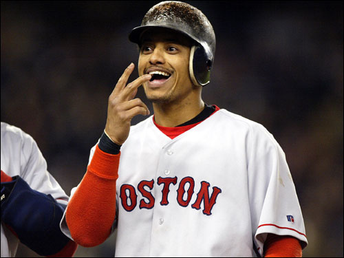 On first base after being hit by a pitch, Orlando Cabrera of the Red Sox smiles when he recognizes someone in the stands.