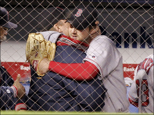 Derek Lowe (right) is embraced by Curt Schilling after leaving the game.
