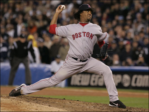Red Sox pitcher Pedro Martinez takes the mound in the seventh inning.