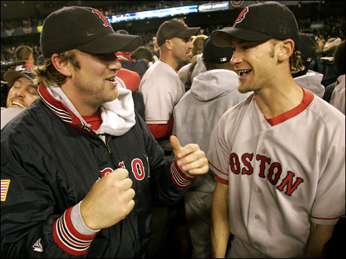 Derek Lowe (left) and Bronson Arroyo celebrate on the field.