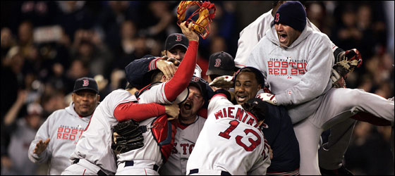 The Red Sox rush the Yankee Stadium turf after beating the Bronx Bombers in Game 7.