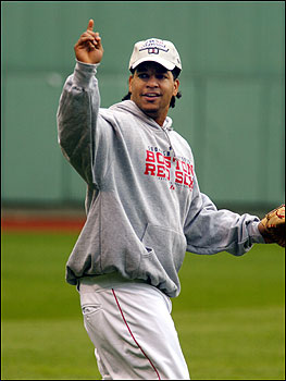 Manny Ramirez waves to a Fenway Park worker in the left field stands.